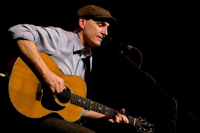 James Taylor playing guitars