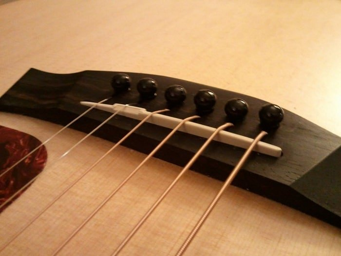 types of acoustic guitar bridges