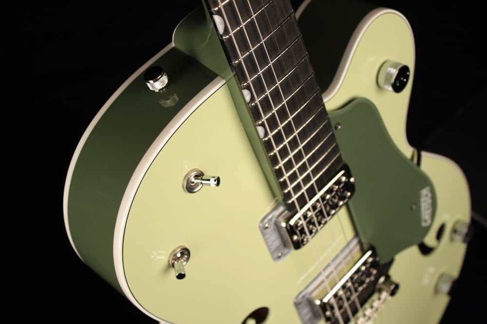 The shape of the Gretsch G6118 is what they call Anniversary. It looks like a modified Les Paul semi hollow design